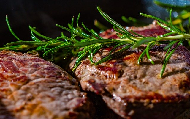 Steaks with fresh rosemary.