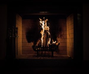 Fire burning in fireplace hearth.